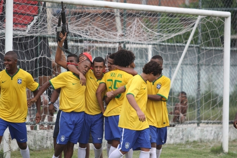 Players for V.A. Clube celebrate after a goal.