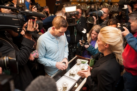 Sean Azzariti, a veteran of the Iraq war, prepares to make the first legal recreational marijuana purchase in Colorado from advocate Betty Aldworth at the 3-D Denver Discrete Dispensary on Jan. 1, 2014 in Denver, Colorado.