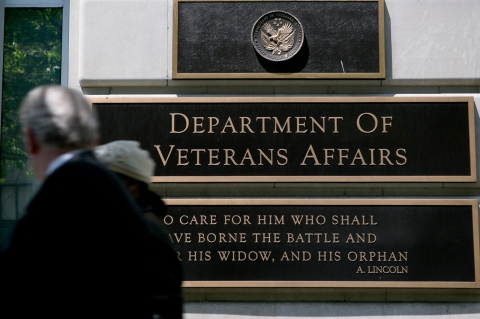 Pedestrians walk past the U.S. Department of Veterans Affairs headquarters in Washington, D.C.