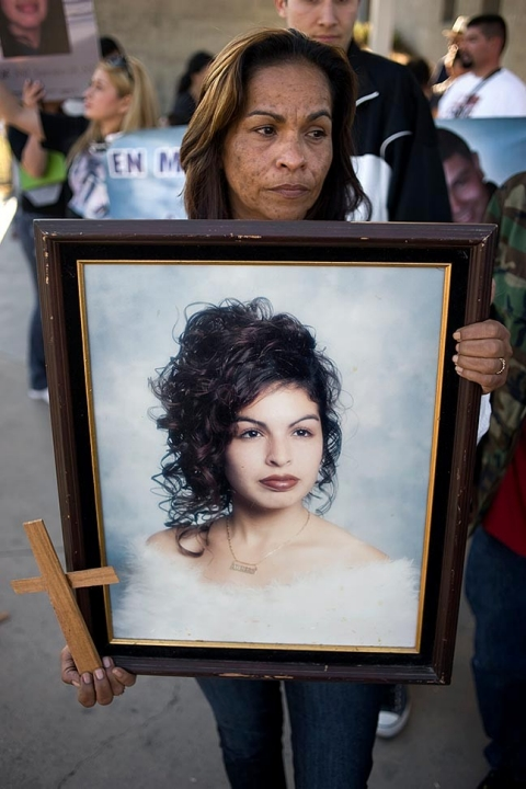Annabell Gomez holds a high school photograph of her daughter, during a protest against the US Border Patrol and US Customs and Border Protection (CBP) in San Diego, California, USA, 23 February 2013.