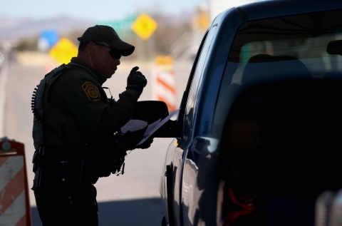 A U.S. Border Patrol agent speaks to a driver at a checkpoint from Mexico into the United States on February 26, 2013 north of Nogales, Arizona.