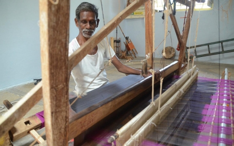 In India, handloom weavers feel the mechanized punch of a