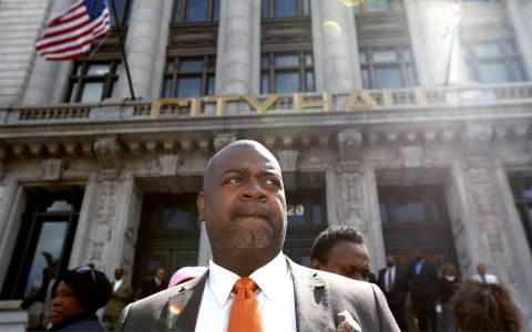 Newark mayoral candidate Ras Baraka looks on before a prayer service on the steps of Newark City Hall, Saturday, April 26, 2014, in Newark, N.J.