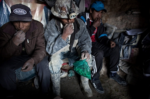 A group of miners chew coca leaves before the Miners Carnival in Potosi, Bolivia
