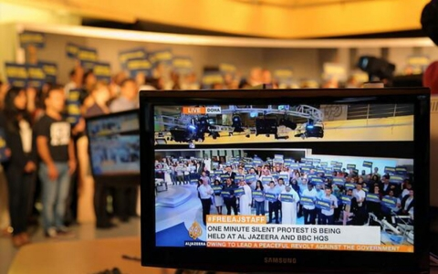 Al Jazeera staff stand in silence for one minute on-air in solidarity with journalists in Egypt.