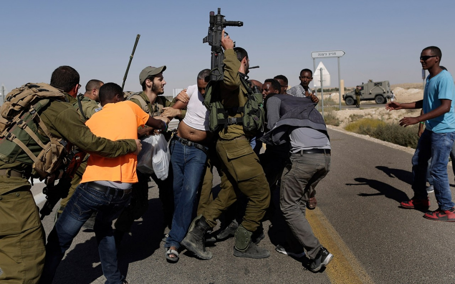 http://america.aljazeera.com/content/ajam/articles/2014/6/29/african-migrantsprotestisraelitreatment/jcr:content/headlineImage.adapt.1460.high.African-Migrant_protest.1404083301725.jpg