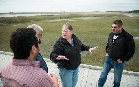 USC's Jenny Pournelle discusses the impact of climate change on the marshes with (l. to r.) Zaid Alattabi, Amjed Alabresm and Dawod Almayahi.