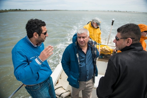 Professors from USC's Baruch Institute for Marine and Coastal Science take Iraqi doctoral students on a tour or South Carolina's marshes.