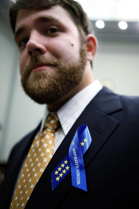 Stephen Stone, Transocean employee and survivor of Deepwater Horizon explosion, wears a blue ribbon on his lapel while testifying to the House Judiciary Committee May 27, 2010 in Washington, DC.
