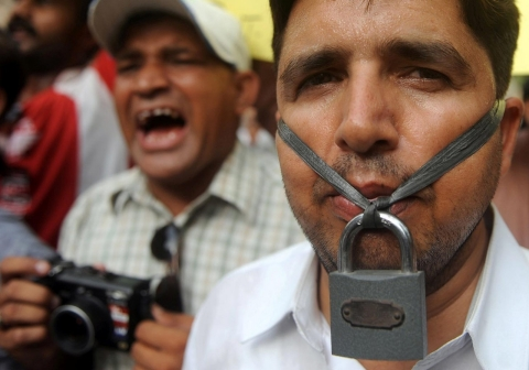 Pakistani journalists stage a demonstration during a protest in Karachi on June 3, 2011, against the killing of Pakistani journalist Saleem Shahzad.