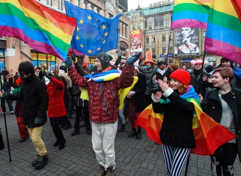 People take part in a procession organised by gay rights activists in central Kiev January 11, 2014.