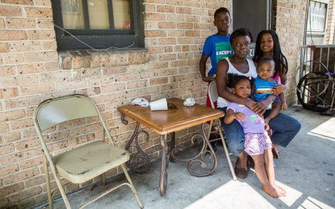 Williana Tadlock is pictured with her grandkids, who she has adopted to make sure they can all live in public housing.