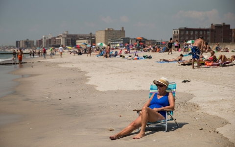 A woman sunbathes at Rockaway Beach during a heat wave on July 17, 2013 in the Rockaway Beach neighborhood of the Queens borough of New York City.