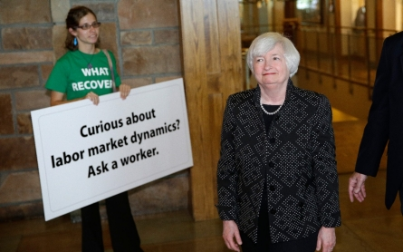 Fed chair cautious on timing of rate rises, questions health of job market