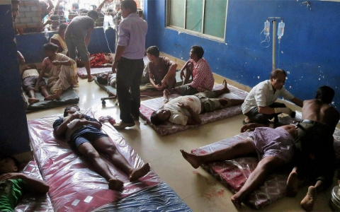 Injured protesters receive treatment at a hospital in Golaghat, India.