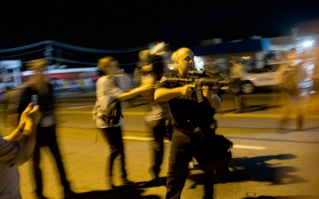 Policeman resigns after pointing rifle at Ferguson protesters