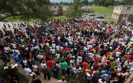Protesters rally three weeks after police shooting of Michael Brown
