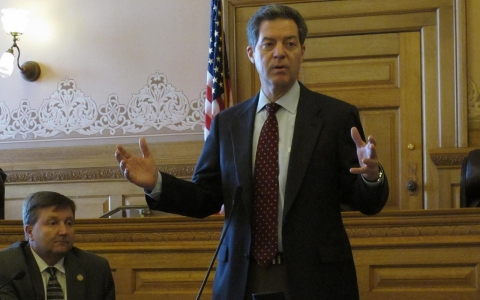 Kansas Gov. Sam Brownback speaks to state House Republicans before they debate a school funding plan, Friday, April 4, 2014, at the Statehouse in Topeka, Kan. Legislators are working on a plan to comply with a Kansas Supreme Court mandate to increase aid to poor school districts.