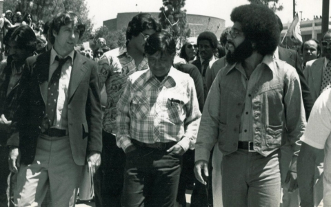 Tom Hayden, Cesar Chavez (United Farmworkers Union), and Ken Msemaji (Nia Cultural Organization) leading the march of the 10th annual Malcolm X Kuzaliwa (birthday) celebration, May 1977