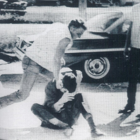 White supremacists pull Tom Hayden from a stopped car and beat him in McComb, Mississippi, 1961