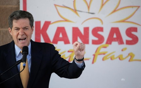 Republican Gov. Sam Brownback, left, answers a question during a debate with  his Democratic challenger, Paul Davis at the Kansas State Fair Saturday, Sept. 6, 2014, in Hutchinson, Kan