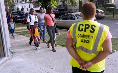 Thumbnail image for Chicago students ushered to school under watch of safety guards