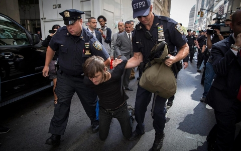 Thumbnail image for Police arrest 104 climate change protesters in Wall Street standoff