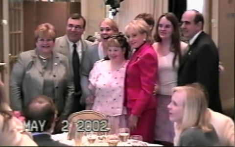 Wolff is honored at a 2002 National Down Syndrome Society event alongside legendary journalist Barbara Walters.