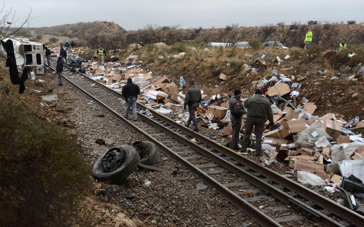 Texas prison bus skids into train, leaving at least 10 dead   Al