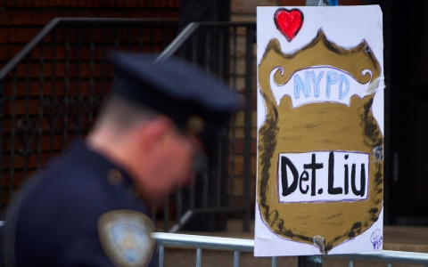 Thumbnail image for At funeral for police officer, scorn for mayor and unease with protests