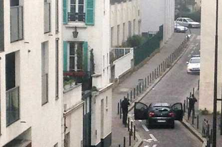 Hunt for gunmen after 12 killed in Paris attack on satirical magazine
