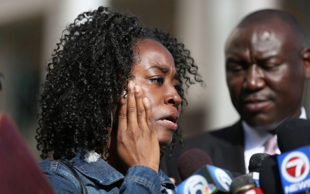 Family of black man killed by Florida police officer demands answers