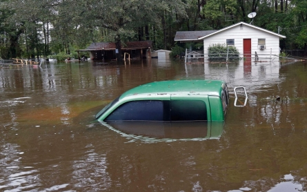 'Fire hose' of rain in Carolinas leaves at least 12 dead