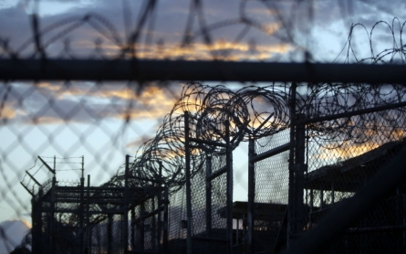 Obama expected to sign defense bill despite clause blocking Gitmo closure