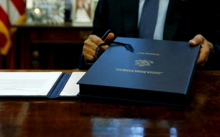 Obama signs budget, debt deal before default deadline