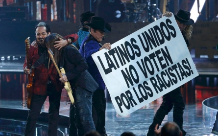 Musicians at Latin Grammys tell viewers: 'Don't vote for racists'
