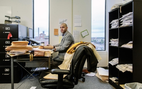 Maximilian Gumina, a public defender in New Orleans, works at his desk.