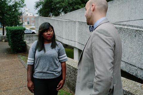 Gumina speaks with Leronisha Williams, his client, in front of the municipal courthouse.