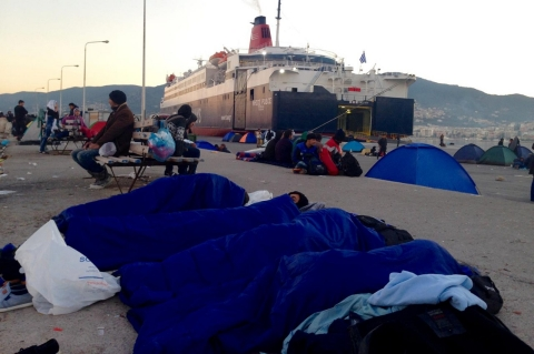 Refugees stranded by the ferry strike sleep on the ground at Mytilene, the main port city of Lesbos.