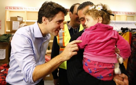 Canada welcomes first planeload of Syrian refugees