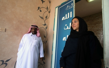 Saudi Arabian women vote, run in local elections for first time