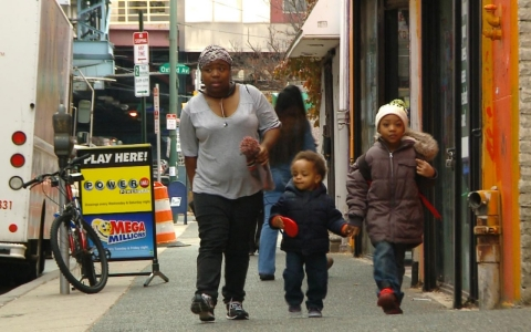 Aleemah Redding walks in Philadelphia with her sons.