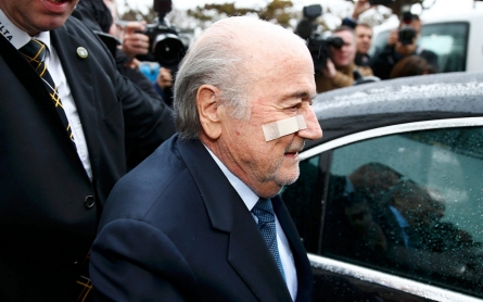 Blatter, Platini banned for eight years by FIFA ethics committee