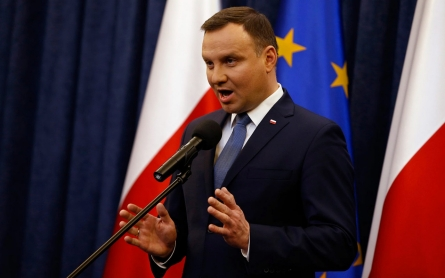 Polish president signs controversial court reforms into law