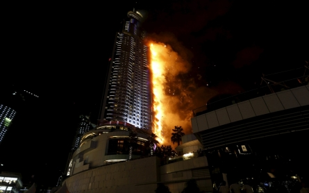 Fire engulfs Dubai skyscraper near world's tallest building