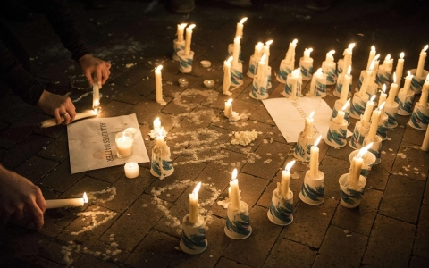 Thumbnail image for In fear and sadness, hundreds gather to honor slain Chapel Hill students