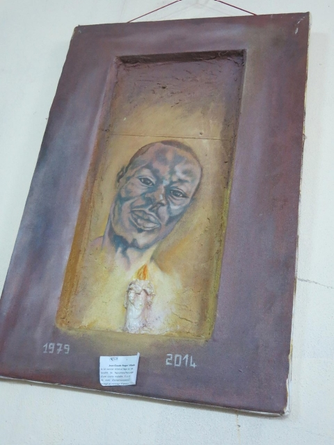 A painting in memory of Roger Mbede hangs in the office of a Cameroonian LGBT organization.