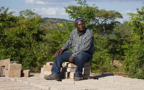 Rabson Wuriga, secretary of the new synagogue in Mutuzu, at the building site.