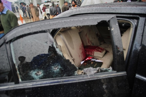 The blood-stained car of Pakistani Minorities Minister Shahbaz Bhatti is seen following an attack in Islamabad on March 2, 2011.