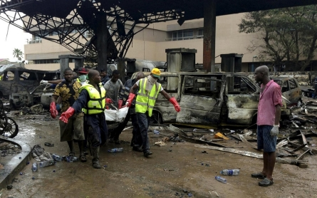 Scores killed in Ghana blast while sheltering from torrential rains